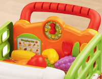 Interactive shopping cart recognizes kitchen utensils to teach words, colors and objects while encouraging hand/eye coordination