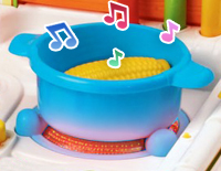 Light-up stove, realistic sound effects and interactive oven knob teach numbers and counting