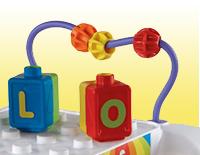 Turning gears, slider and beads strengthen fine motor skills