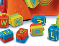 13 double-slided blocks are identified, teaching children the alphabet