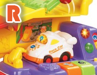 "Includes one SmartPoint™ race car that teaches the letter ""R"" and the name of the vehicle through pretend play"