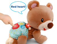 Heart button causes the bear to crawl and say fun phrases