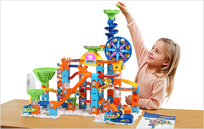 Child dropping marble down the funnel on Marble Rush Ultimate Set.