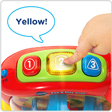 Three light-up buttons introduce colors, numbers, and shapes.