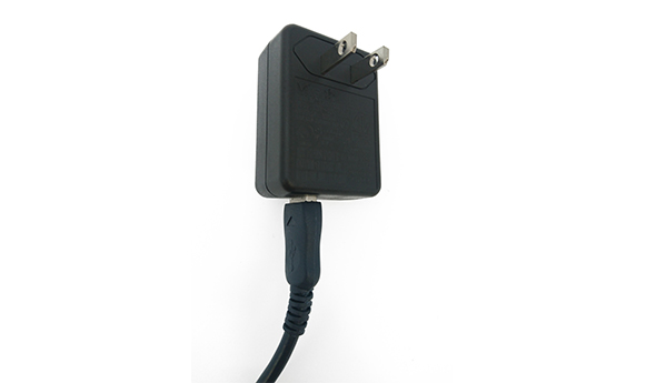 Insert the large end of the USB cable into the AC adapter plug